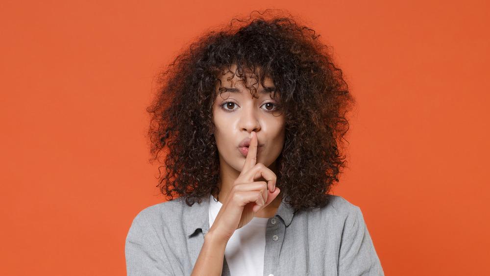 "Woman saying ""shhh"""