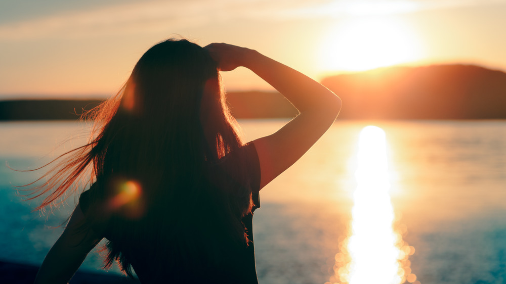 Woman shields her eyes from the sun