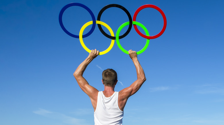 Man holding Olympic rings