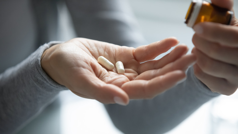 Pills in a woman's hand