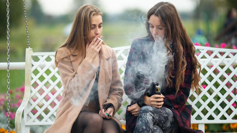 Two women smoking and vaping