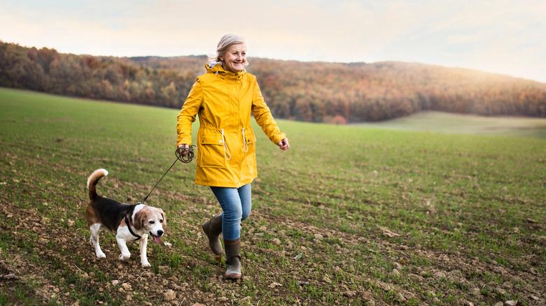 A woman walks her dog