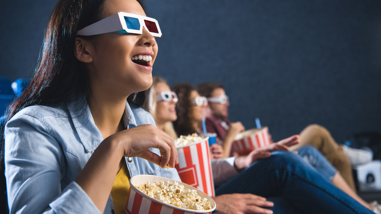 Group of friends wearing 3D glasses in a movie theater