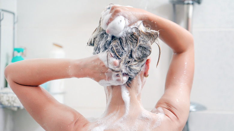 A woman washes her hair