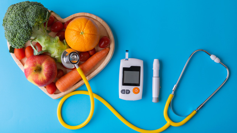 Fruits and veggies with diabetes monitor and stethoscope
