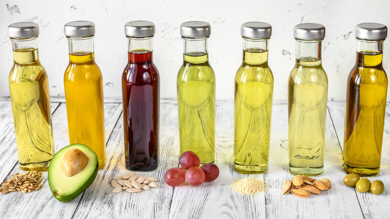 different oils set up on glass bottles with their foods