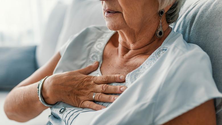 older woman grabbing her chest