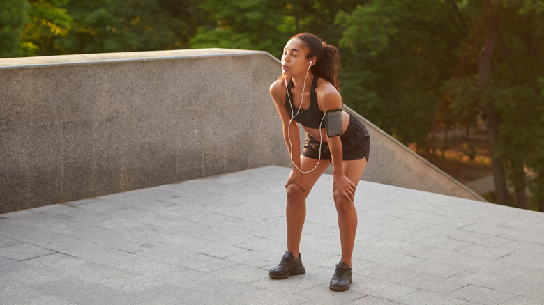 Woman takes a break from her run