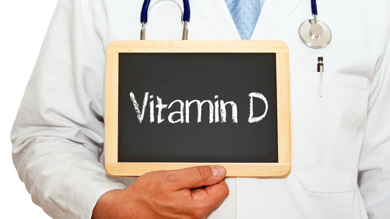 doctor holding vitamin D sign