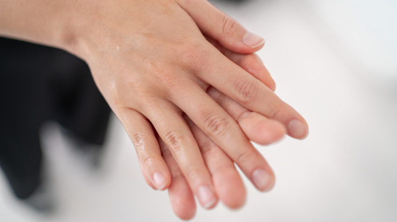 Woman with hands touching