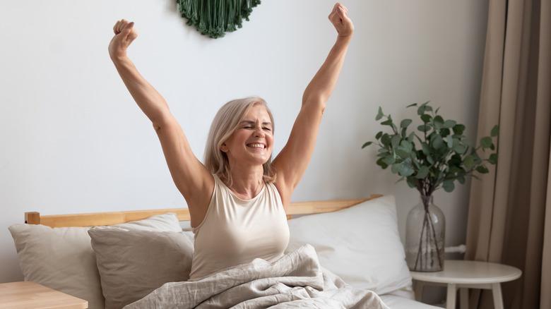 Happy woman waking up