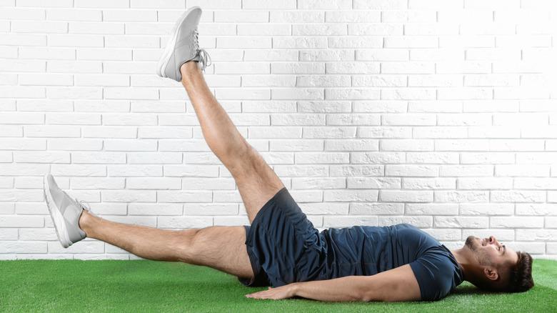 man doing leg lift