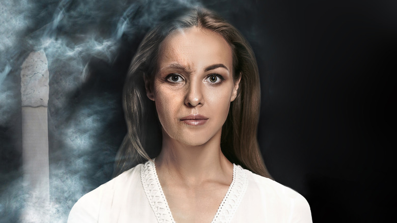 Concept of premature aging resulting from smoking on a young woman