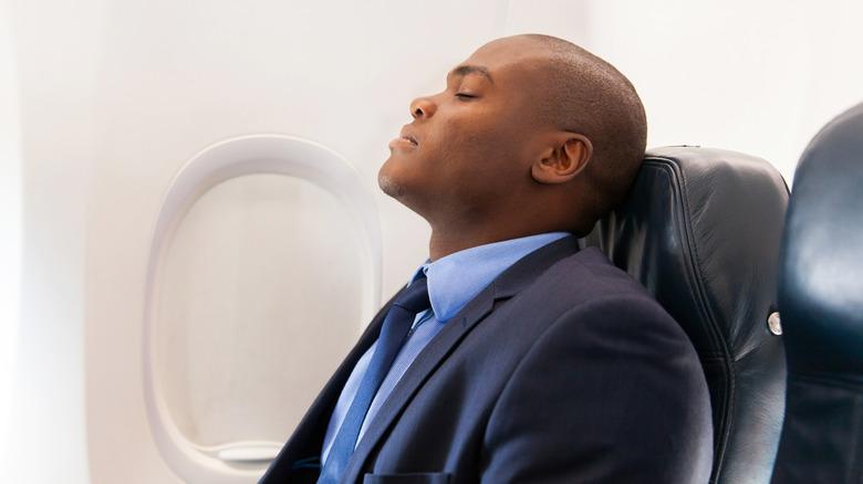 tired man on airplane