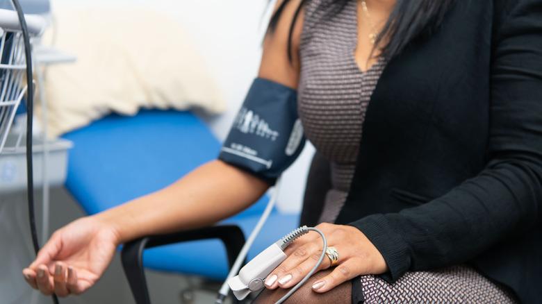woman having blood pressure taken
