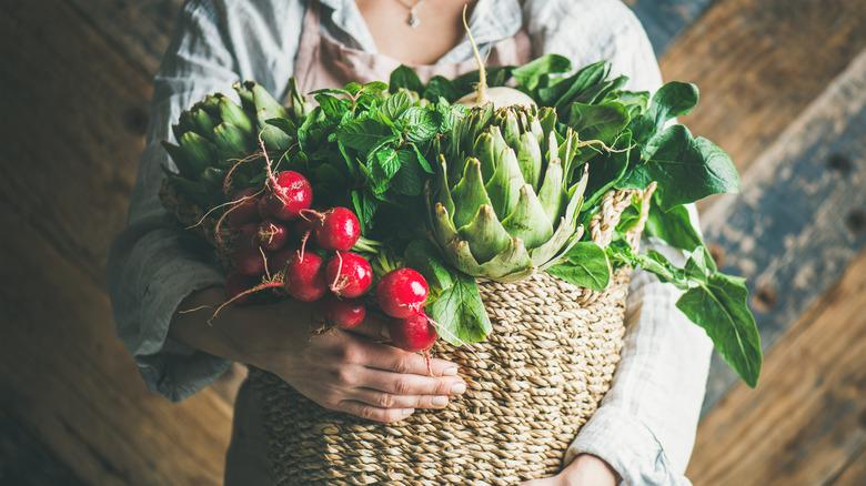 Woman with basket of veggies