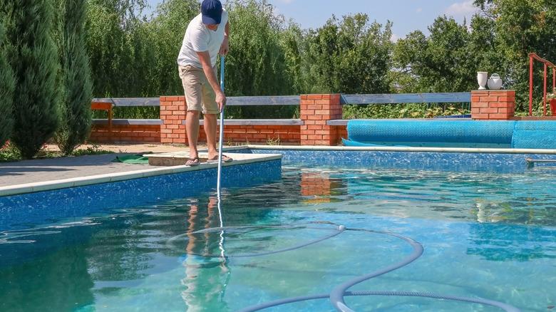Man doing pool maintenance