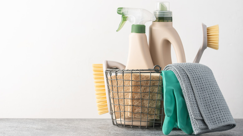 A wire basket filled with natural cleaning products