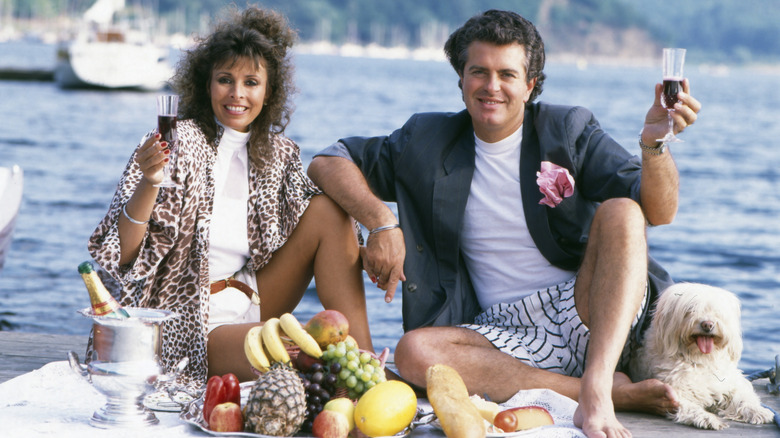'80s couple on a pier with a platter of fruit