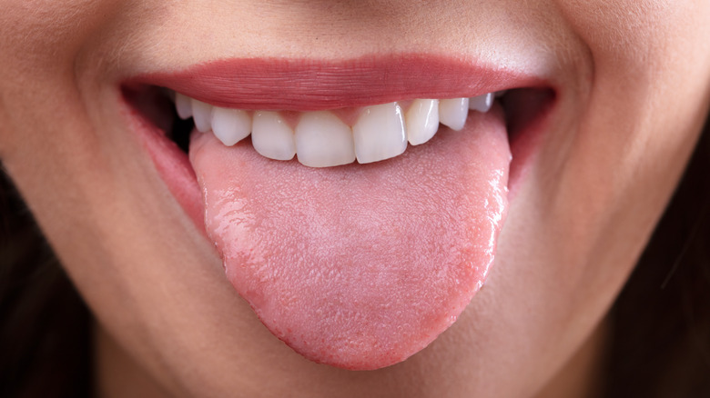 Close-up of woman's face with tongue sticking out