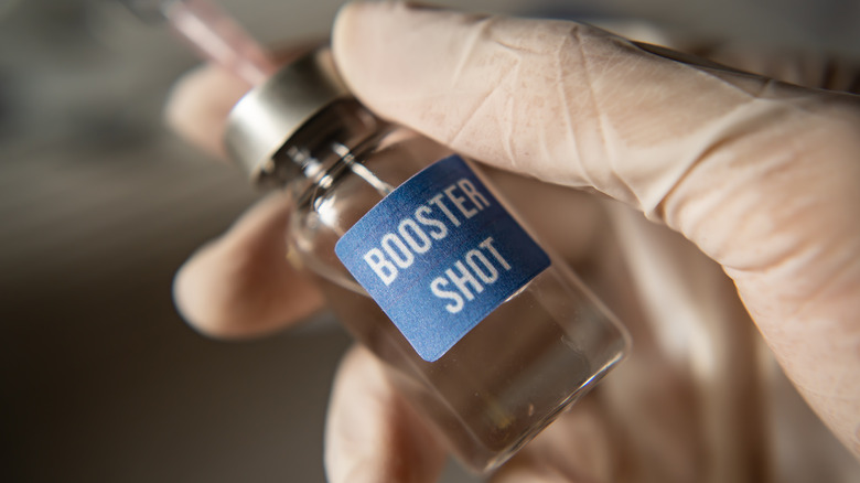 close up of glass container labeled 'Booster Shot'
