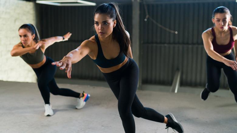 Women doing side skater exercise