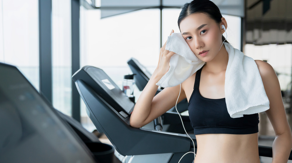 woman cooling down on treadmill