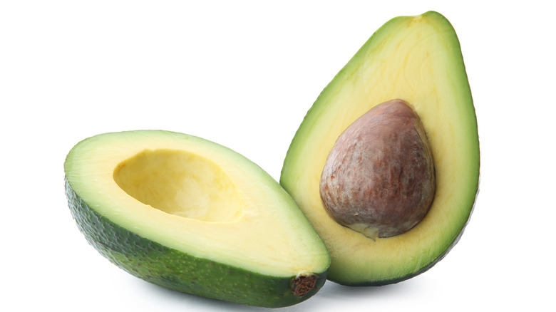 Avocado halved with pit