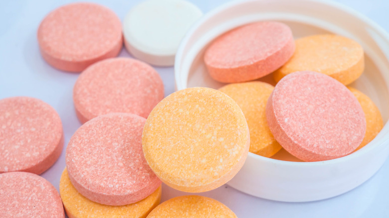 antacids in pink and orange colors close up