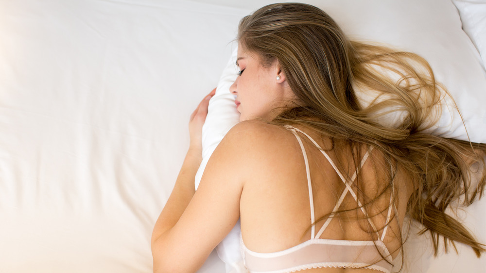 Woman sleeping in white bra