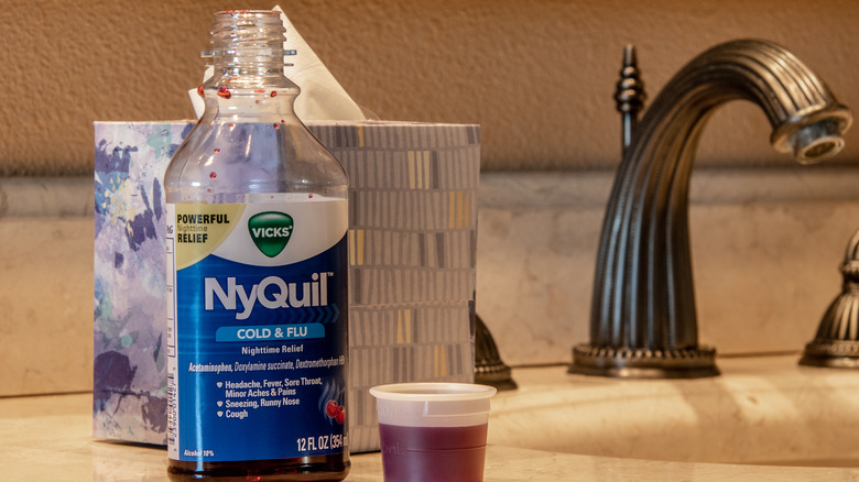 Nyquil sits on the counter in a bathroom