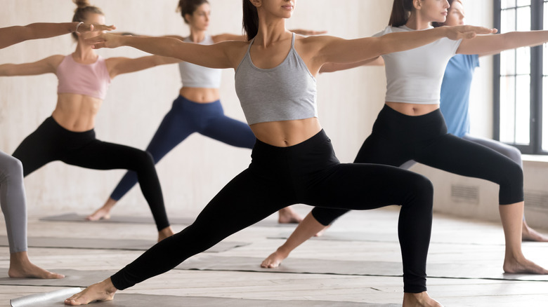 Women doing lunges in exercise class