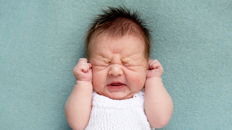 Irritable infant in pain from teething