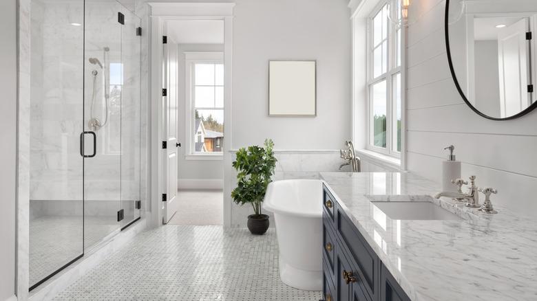 White bathroom with shower, bathtub and sink