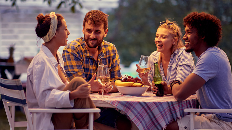 Group of friends drinking beer and wine outdoors