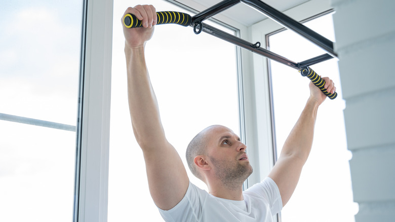 A man preparing to do a pull-up