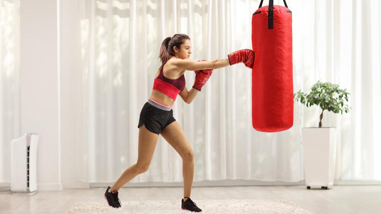 Woman boxing at home
