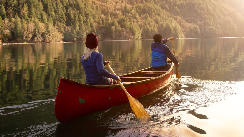 Two people in a canoe on a calm river