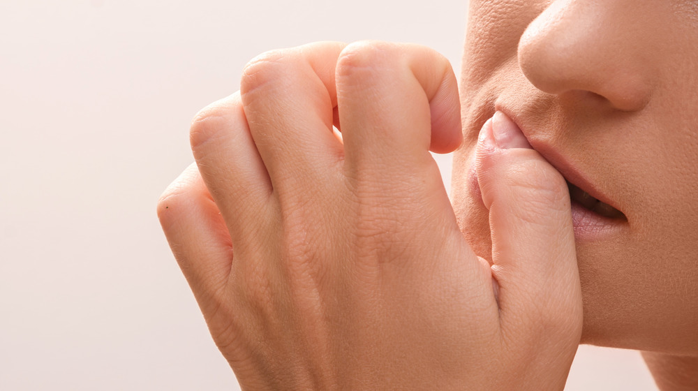 Woman biting nails