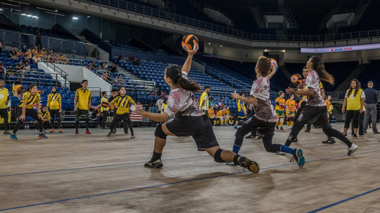 two competitive dodgeball teams playing a match