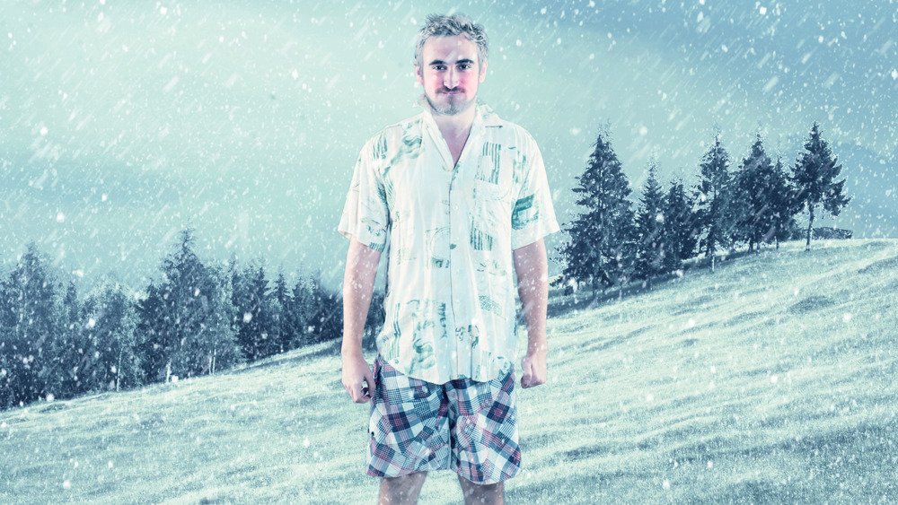 man in shorts in snow