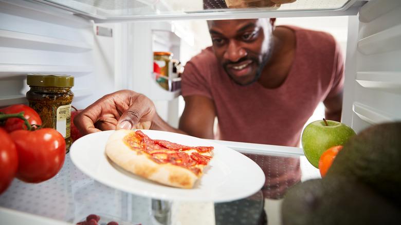 pepperoni pizza slice in refrigerator