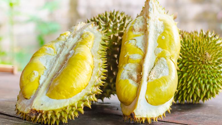 two cut open durian fruits