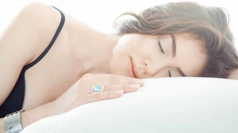 brunette woman sleeping with jewelry on