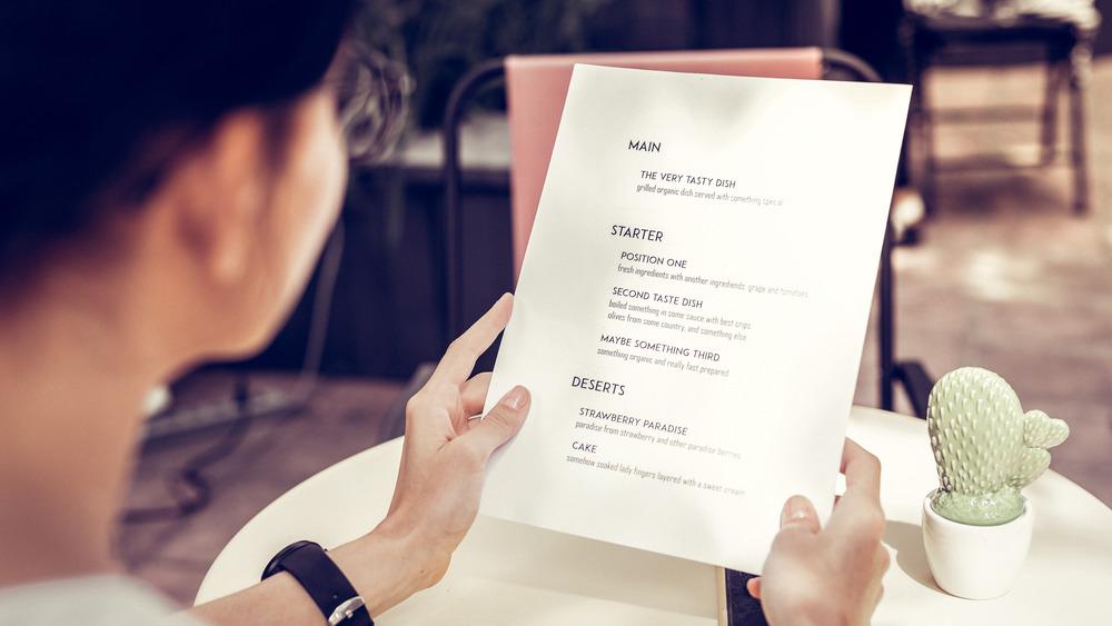 Woman looking at menu