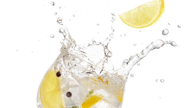 Lemon splashing into a drink