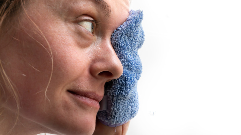 woman using microfiber washcloth to clean face