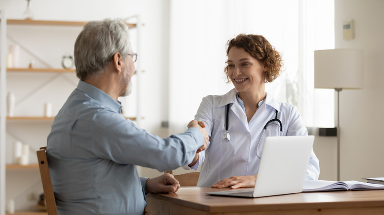 A man talks to his doctor at an appointment