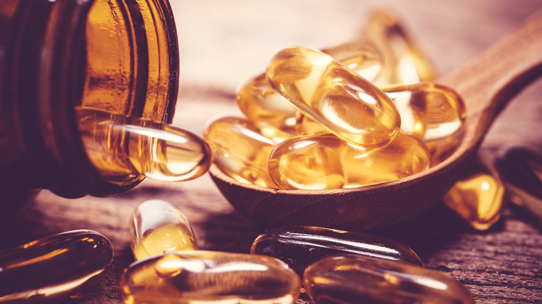 Fish oil supplements in a spoon