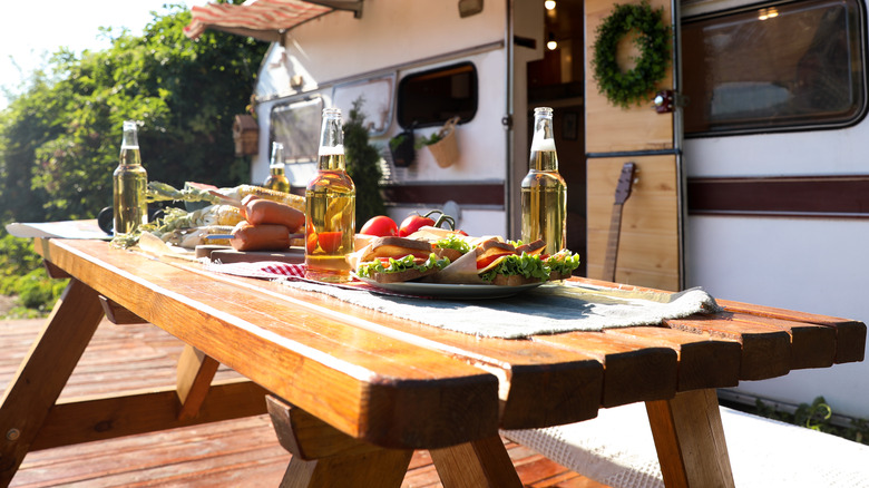 Food on a picnic table on a sunny day